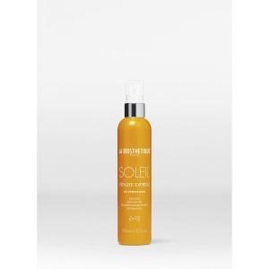 Двухфазный лосьон защищает и улучшает поврежденные солнцем волосы/Vitalité Express